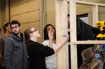 IAD student building playhouses